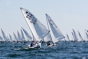 Nick Craig leads the Fleet of OK dinghies in race 2