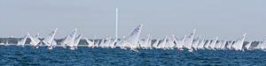 The Fleet of OK dinghies downwind